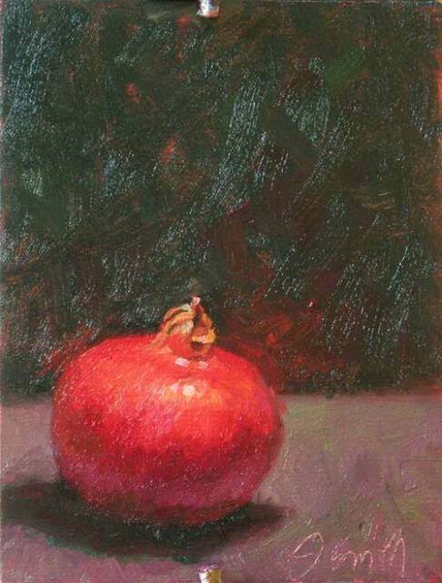 Oil painting showing a red pomegranate sitting on a wood table top